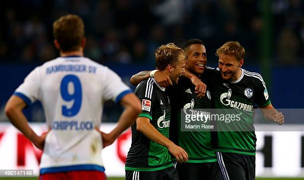 Johannes geis Dennis Aogo and Benedikt Hoewedes of Schalke celebrate after the Bundesliga match between Hamburger SV and FC Schalke 04 at...