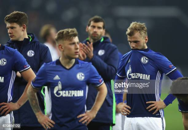 Johannes Geis of FC Schalke 04 and team mates look dejected after the UEFA Europa League quarter final second leg match between FC Schalke 04 and...