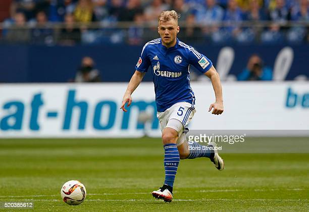 Johannes Geis of FC Schalke 04 runs with the ball during the Bundesliga match between FC Schalke 04 and Borussia Dortmund at VeltinsArena on April 10...