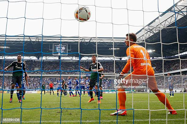 Johannes Geis of FC Schalke 04 takes and scores a free kick past Goalkeeper Michael Ratajczak of MSV Duisburg during the DFB Cup match between MSV...