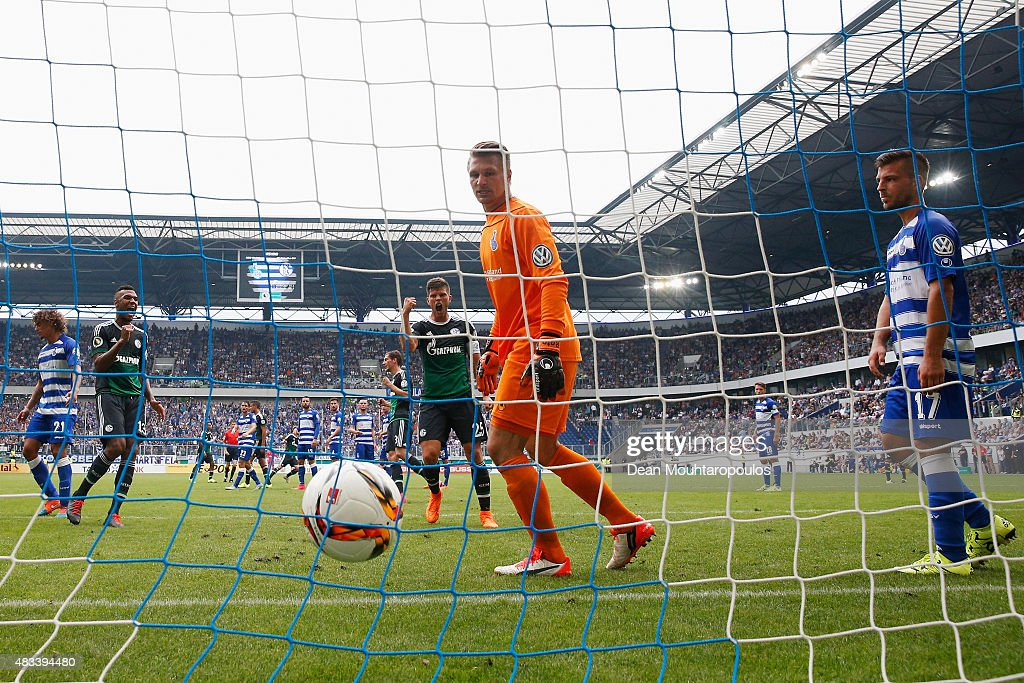 Johannes Geis of FC Schalke 04 takes and scores a free kick past Goalkeeper, Michael Ratajczak of MSV Duisburg during the DFB Cup match between MSV Duisburg and FC Schalke 04 held at Schauinsland-Reisen-Arena on August 8, 2015 in Duisburg, Germany.