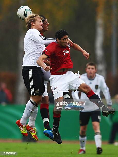 Johannes Geis of Germany jumps for a header with Ahmed Hassan Mohamed Mahgoub and Mohamed Rizk Lotfi Abdelbasit of Egypt during the U19 International...