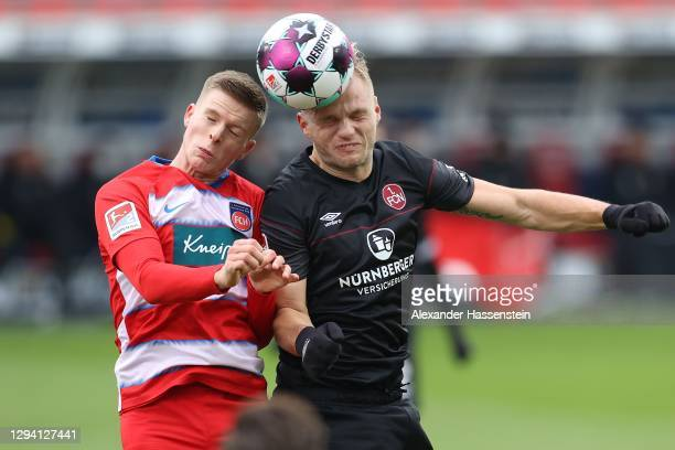 Johannes Geis of Nürnberg battles for the ball with Dzenis Burnic of Heidenheim during the Second Bundesliga match between 1. FC Heidenheim 1846 and...