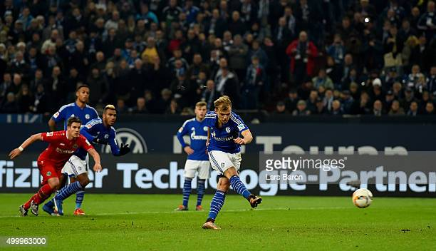 Johannes Geis of Schalke scores his teams first goal during the Bundesliga match between FC Schalke 04 and Hannover 96 at VeltinsArena on December 4...