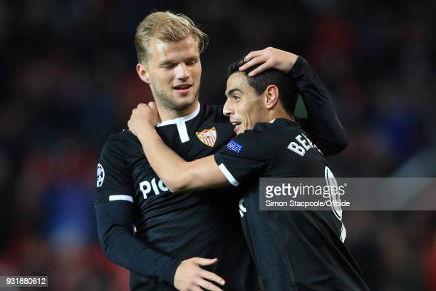 Johannes Geis of Sevilla celebrates victory with Wissam Ben Yedder of Sevilla during the UEFA Champions League Round of 16 Second Leg match between...