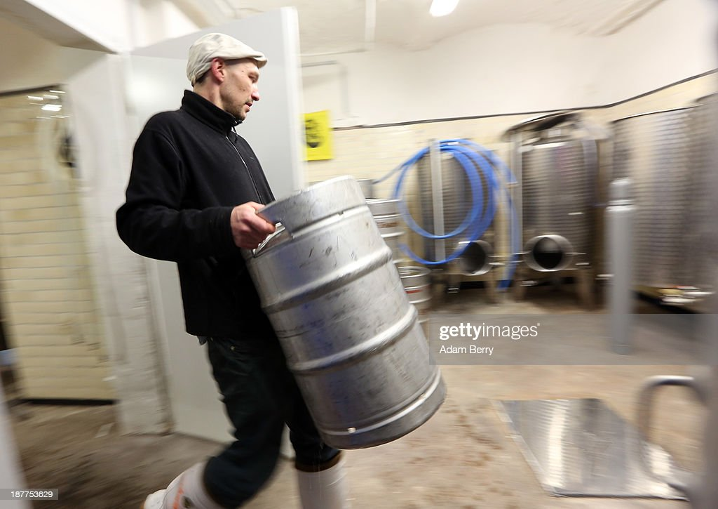 Johannes Heidenpeter, owner of Heidenpeters brewery, carries a keg of beer on November 12, 2013 in Berlin, Germany. In a country known for centuries for its beer, several microbreweries have opened within the past year that are not only bending traditional rules on the types of ingredients used, opting for American-style hops such as Amarillo and Cascade instead of German ones, but also moving beyond the official legal doctrine, known as the Reinheitsgebot, or 'German Beer Purity Law,' which stated that water, barley and hops were the only ingredients allowed in the production of the beverage. While the law has since been expanded, it continues to be referenced on beer bottles for marketing purposes.