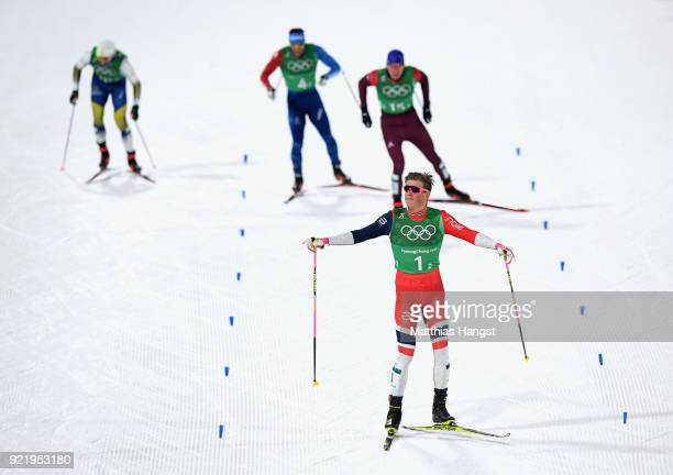 Johannes Hoesflat of Norway celebrates as he approaches the finish line to win gold during the Cross Country Men's Team Sprint Free Final on day 12...