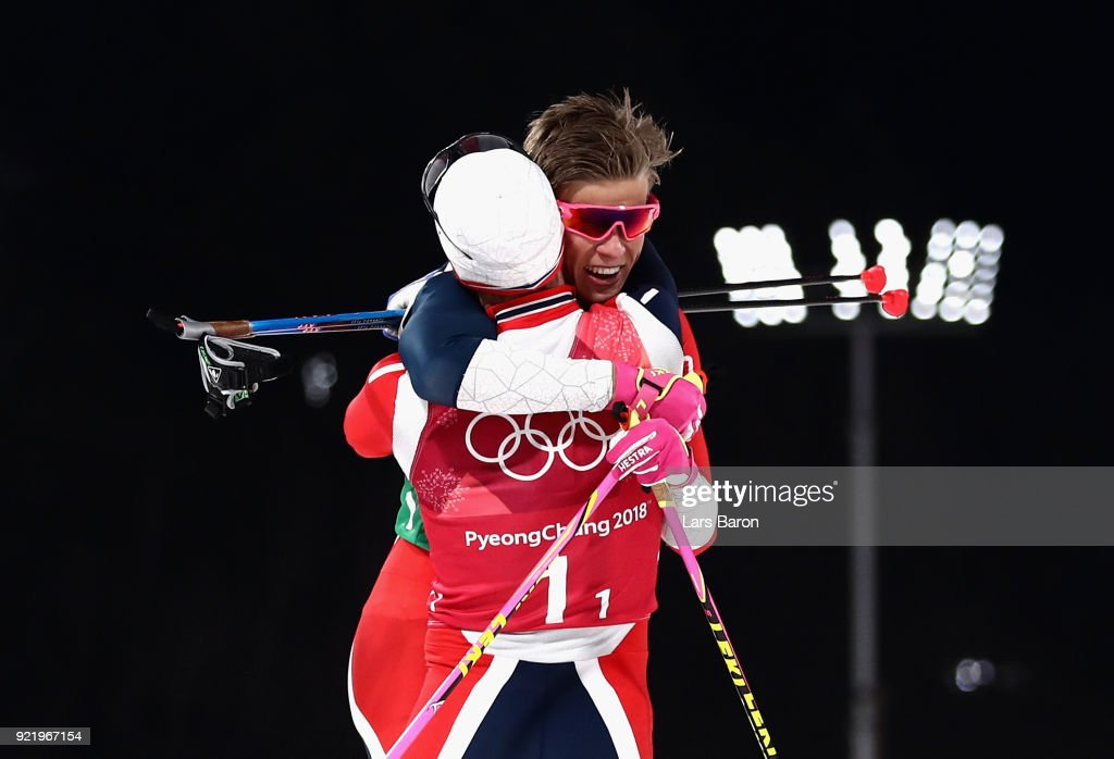 Johannes Hoesflat of Norway (1-2) celebrates as he crosses the finish line to win gold with team mate Martin Johnsrud Sundby of Norway during the Cross Country Men's Team Sprint Free Final on day 12 of the PyeongChang 2018 Winter Olympic Games at Alpensia Cross-Country Centre on February 21, 2018 in Pyeongchang-gun, South Korea.