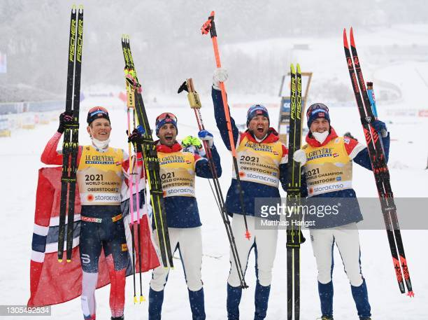 Johannes Hoesflot Klaebo, Hans Christer Holund, Emil Iversen and Paal Golberg of Norway celebrate first place during the Men's Cross Country 4x10 km...