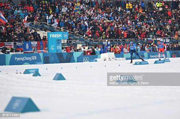 Johannes Hoesflot Klaebo of Norway Adrien Backscheider of France in action during the CrossCountry Men's Relay at Alpensia CrossCountry Centre on...