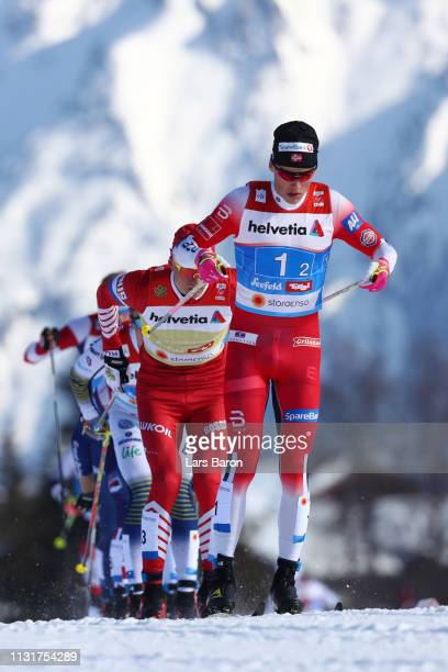 Johannes Hoesflot Klaebo of Norway and Alexander Bolshunov of Russia compete in the first semifinal run for the Mens' Cross Country Team Sprint...