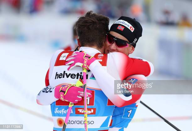 Johannes Hoesflot Klaebo of Norway and Emil Iversen of Norway celebrates following their victory in the Mens' Cross Country Team Sprint during FIS...