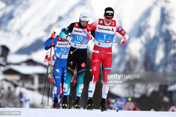 Johannes Hoesflot Klaebo of Norway and Lucas Chanavat of France compete in the final for the Mens' Cross Country Team Sprint during FIS Nordic World...
