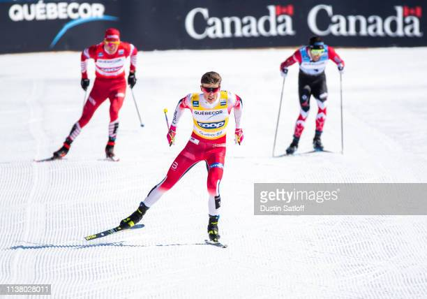 Johannes Hoesflot Klaebo of Norway approaches the finish line in first place in the Men's 15km freestyle pursuit during the FIS Cross Country Ski...