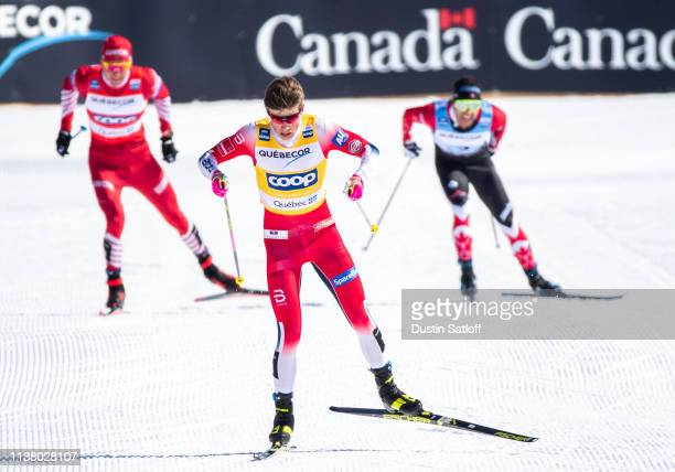 Johannes Hoesflot Klaebo of Norway approaches the finish line in first place ahead of Alexander Bolshunov of Russia and Alex Harvey of Canada in the...