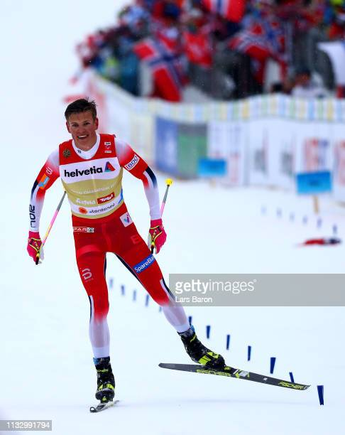 Johannes Hoesflot Klaebo of Norway celebrates after winning the Men's Cross Country Relay during the 2019 FIS Nordic World Ski Championships at Cross...