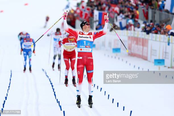 Johannes Hoesflot Klaebo of Norway celebrates as he approaches the finish line to win the Mens' Cross Country Team Sprint along with Emil Iversen of...