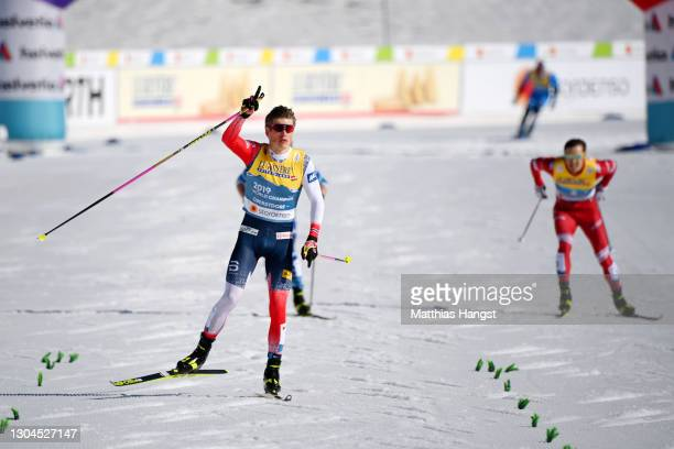 Johannes Hoesflot Klaebo of Norway celebrates as he approaches the finish line for them to win the Men's Cross Country Team Sprint Finals at the FIS...
