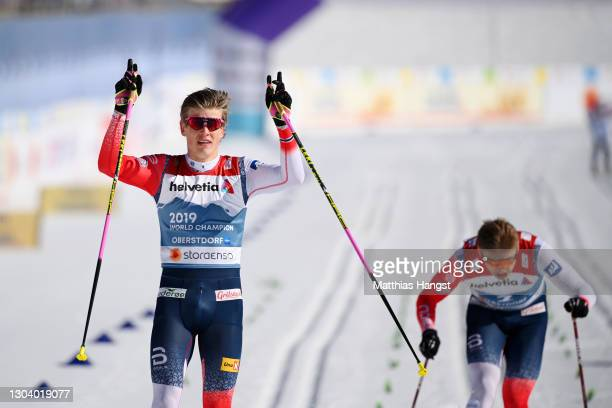 Johannes Hoesflot Klaebo of Norway celebrates as he crosses the finish line to win the Men's Cross Country SP C Final at the FIS Nordic World Ski...