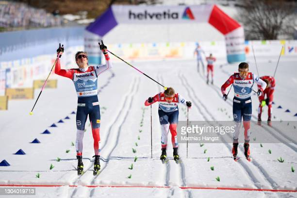 Johannes Hoesflot Klaebo of Norway celebrates as he crosses the finish line to win ahead of his countrymen Erik Valnes and Haavard Solaas Taugboel in...