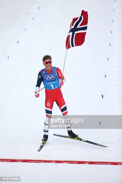 Johannes Hoesflot Klaebo of Norway celebrates on his way to winning the gold medal during CrossCountry Skiing men's 4x10km relay on day nine of the...