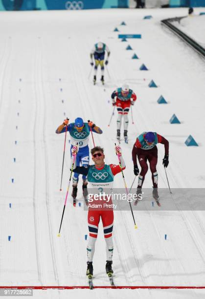 Johannes Hoesflot Klaebo of Norway celebrates winning gold during the Cross-Country Men's Sprint Classic Final on day four of the PyeongChang 2018...