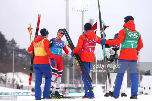 Johannes Hoesflot Klaebo of Norway celebrates with teammates Didrik Toenseth Martin Johnsrud Sundby and Simen Hegstad Krueger after winning the gold...