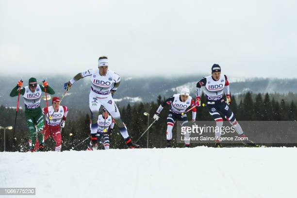 Johannes Hoesflot Klaebo of Norway competes Calle Halfvarsson of Sweden competes Federico Pellegrino of Italy takes joint 1st place during the FIS...