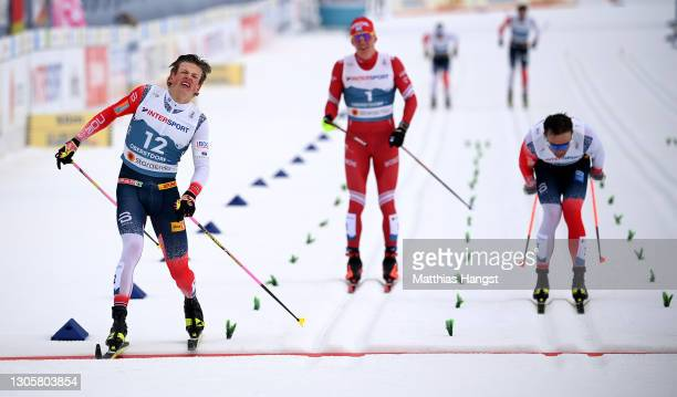 Johannes Hoesflot Klaebo of Norway crosses the finish line to take first place during the Men's Cross Country 50km Mst at the FIS Nordic World Ski...