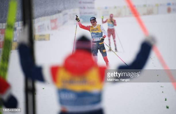 Johannes Hoesflot Klaebo of Norway heads towards the finish line in first place during the Men's Cross Country 4x10 km Relay at the FIS Nordic World...