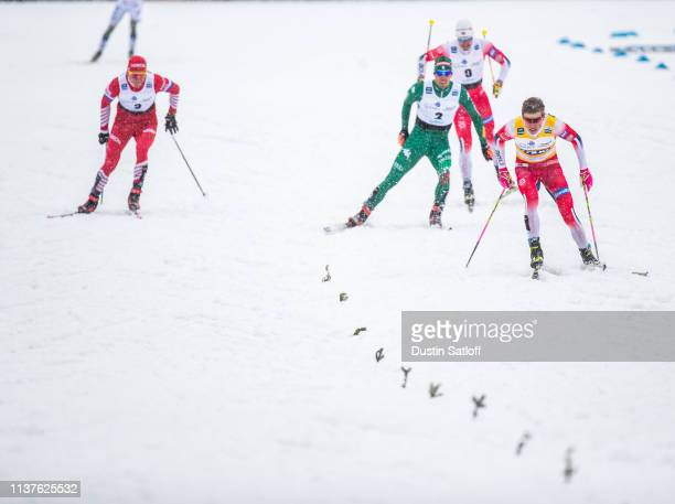 Johannes Hoesflot Klaebo of Norway leads Federico Pellegrino of Italy and Alexander Bolshunov of Russia on his way to winning the sprint final heat...