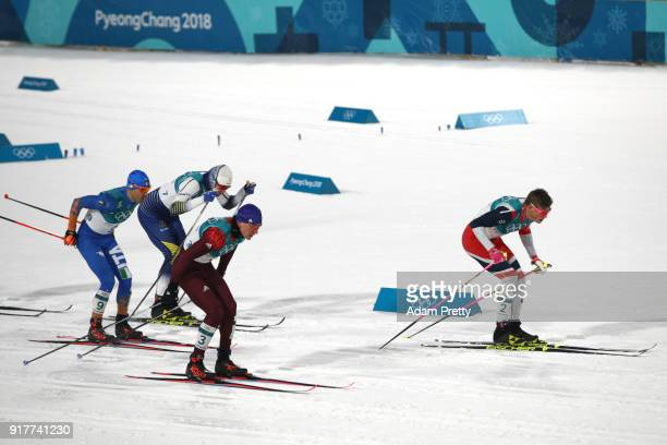 Johannes Hoesflot Klaebo of Norway leads the field during the CrossCountry Men's Sprint Classic Final on day four of the PyeongChang 2018 Winter...