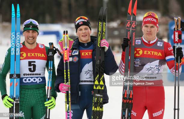 Johannes Hoesflot Klaebo of Norway takes 1st place Francesco De Fabiani of Italy takes 2nd place Alexander Bolshunov of Russia takes 3rd place during...