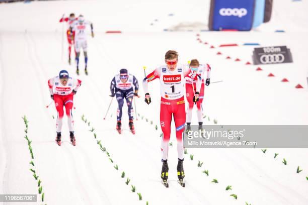 Johannes Hoesflot Klaebo of Norway takes 1st place Paal Golberg of Norway takes 2nd place Erik Valnes of Norway takes 3rd place during the FIS Nordic...