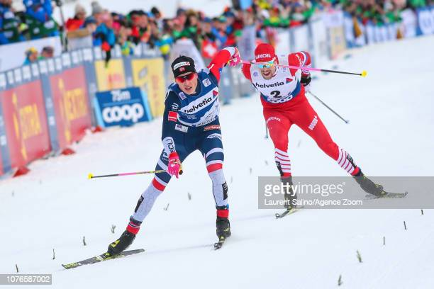 Johannes Hoesflot Klaebo of Norway takes 1st place Sergey Ustiugov of Russia takes 2nd place during the FIS Nordic World Cup Men's and Women's Cross...