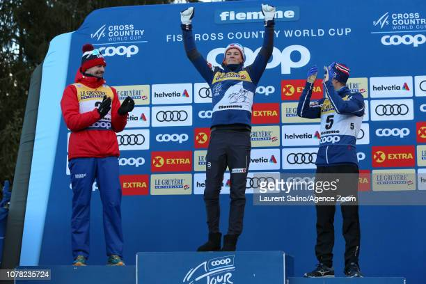 Johannes Hoesflot Klaebo of Norway takes 1st place, Sergey Ustiugov of Russia takes 2nd place, Simen Hegstad Krueger of Norway takes 3rd place during...