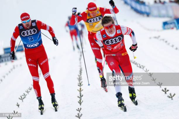 Johannes Hoesflot Klaebo of Norway takes 1st place, Sergey Ustiugov of Russia takes 2nd place, Alexander Bolshunov of Russia takes 3rd place during...