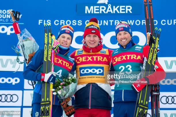 Johannes Hoesflot Klaebo of Norway takes second place, Alexander Bolshunov of Russia takes first place, Emil Iversen of Norway takes third place...