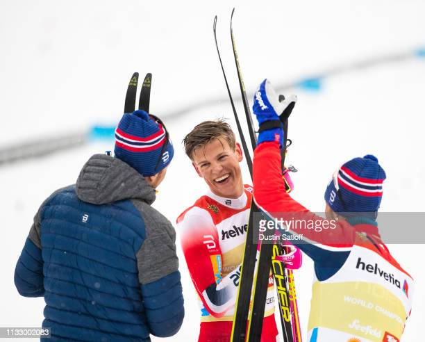 Johannes Hoesflot Klaebo of Norway with Emil Iversen of Norway and Martin Johnsrud Sundby of Norway after winning the Men's 4x10km Cross Country...