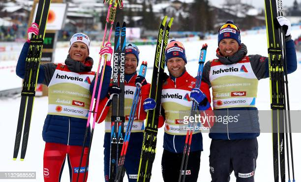 Johannes Hoesflot Klaebo, Sjur Roethe, Johnsrud Martin Sundby and Emil Iversen of Norway celebrate winning the gold medal in the Men's Cross Country...