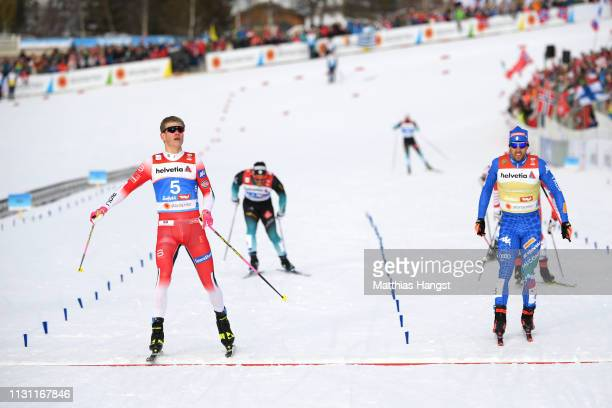 Johannes Hoesflot of Norway crosses the line to celebrate victory during the Men's Cross Country Sprint Final at the Stora Enso FIS Nordic World Ski...