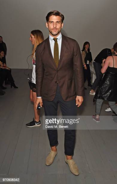 Johannes Huebl attends the Christopher Raeburn show during London Fashion Week Men's June 2018 at the BFC Show Space on June 10 2018 in London England