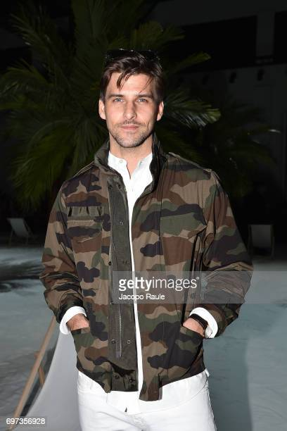 Johannes Huebl attends the Moncler Gamme Bleu show during Milan Men's Fashion Week Spring/Summer 2018 on June 18 2017 in Milan Italy