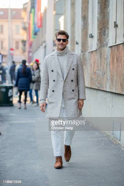 Johannes Huebl is seen wearing creme white turtleneck, double breasted wool coat, white pants outside Marni during Milan Men Fashion Week Fall Winter...