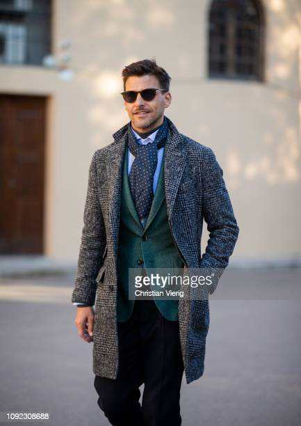 Johannes Huebl is seen wearing grey wool coat green blazer jacket scarf sunglasses during the 95th Pitti Uomo at Fortezza Da Basso on January 10 2019...