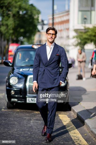 Johannes Huebl waring navy suit is seen outside Iceberg during London Fashion Week Men's June 2018 on June 8 2018 in London England