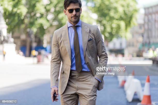 Johannes Huebl wearing a beige suit during the London Fashion Week Men's June 2017 collections on June 11 2017 in London England