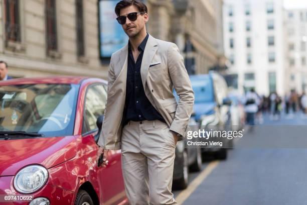 Johannes Huebl wearing a beige suit is seen outside Salvatore Ferragamo during Milan Men's Fashion Week Spring/Summer 2018 on June 18, 2017 in Milan,...