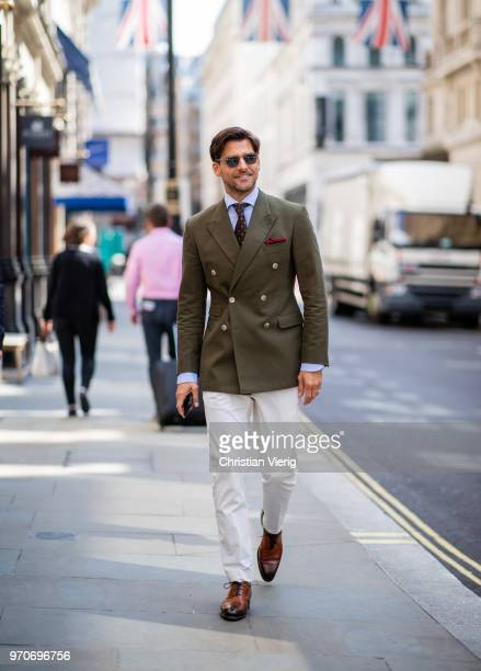 Johannes Huebl wearing green jacket, creme white pants is seen during London Fashion Week Men's June 2018 on June 9, 2018 in London, England.