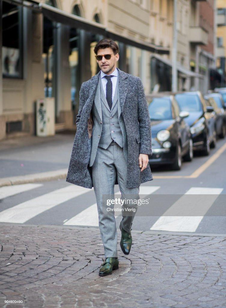 Johannes Huebl wearing grey suit, grey coat is seen outside Daks during Milan Men's Fashion Week Fall/Winter 2018/19 on January 14, 2018 in Milan, Italy.